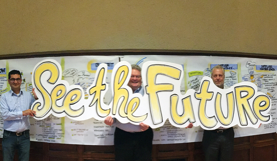 See the Future graphic held by three corporate team member after graphic facilitation session